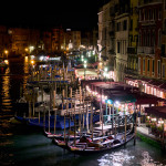 View of Venice canal and gondolas at night