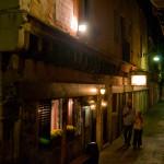 Venice alley at night, couple enjoying gelato